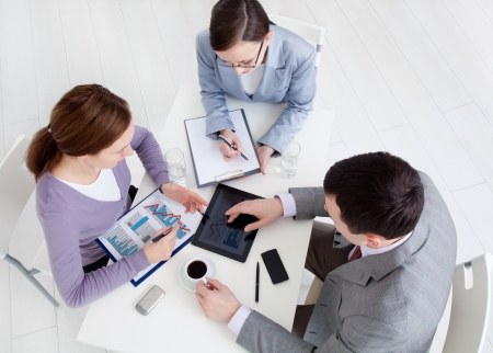young office workers: Contemporary business people working in team in the office  Stock Photo