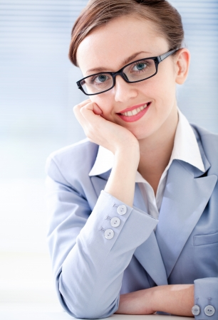 business attire teacher: Portrait of positive well-dressed young woman