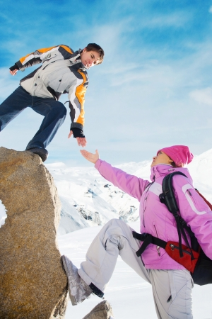 snow climbing: Two climbers ascend the mountain Stock Photo