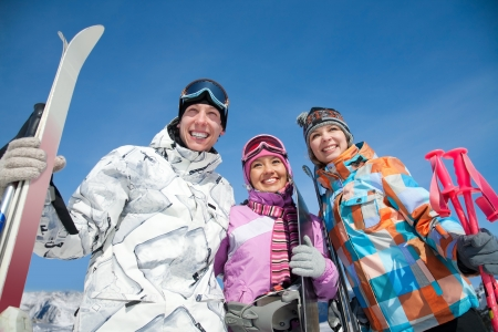 skiers: Portrait of group of friends with skis Stock Photo