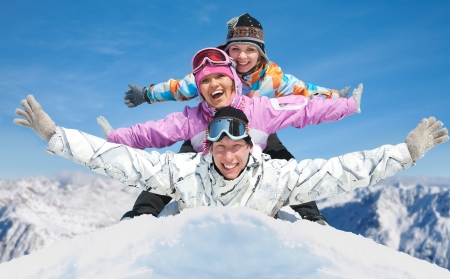 snowboard: Group of young friends enjoying  in winter resort