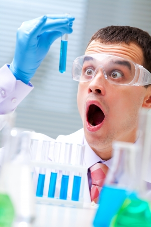 man scientist holding a test tube with liquid Stock Photo - 17510208