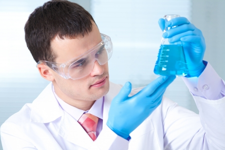 man scientist holding a test tube with liquid Stock Photo - 17510193