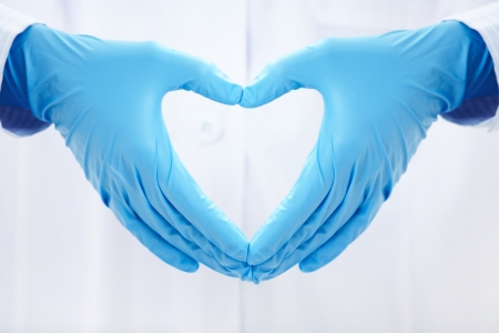 people helping: human hands folded in the form of the heart Stock Photo