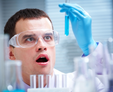 man scientist holding a test tube with liquid Stock Photo - 17510182