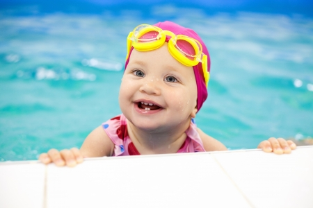 swimming to float: Portrait of little baby swimming  in swimming pool