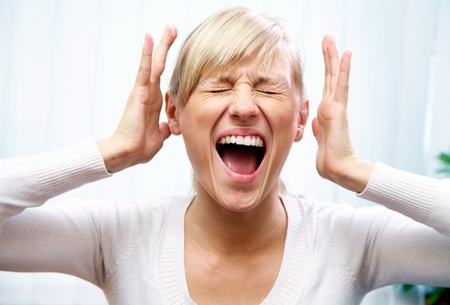 young woman shows off her emotional fear and  scream Stock Photo