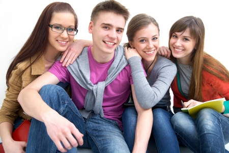 secondary schools: Close-up of four teenagers laughing and looking at camera Stock Photo