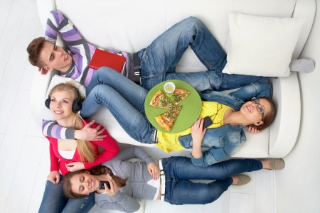 Group of teenagers having leisure-time together photo