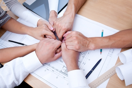 project manager: picture of hands  solidarity team