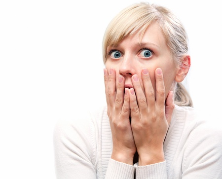 fear face: young blond woman with  expression of surprise on his face Stock Photo