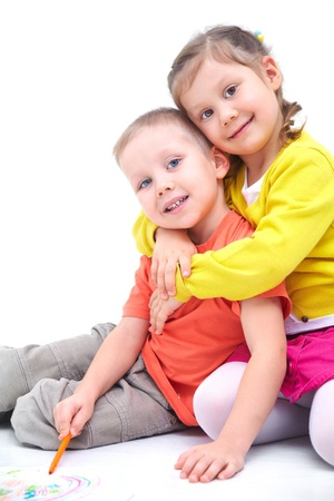 school age boy: Portrait of funny little boy and a cute girl hugging