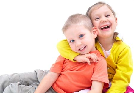 friend hug: Portrait of funny little boy and a cute girl hugging