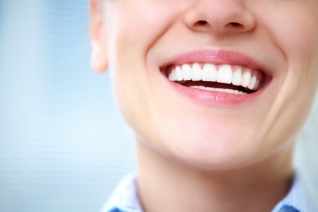 saliva: Close-up of female smile with healthy teeth Stock Photo