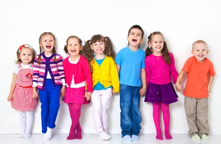 cute kid: Big  group of diverse children  at  white wall