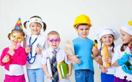 dressing up: Group of six children dressing up as professions