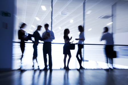 Severa  silhouettes of businesspeople interacting  background business centre Stock Photo - 18356506