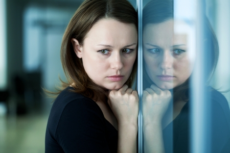 leaned: young woman  woman leaned against glass wall in crisis moment