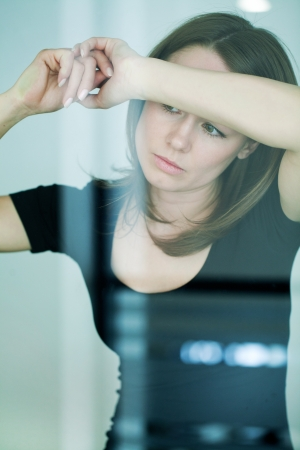 leaned: young woman leaned against glass wall in crisis moment  Stock Photo