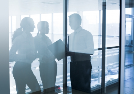 business centre: reflex of Several  businesspeople interacting  background business centre