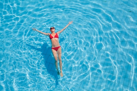 Young woman relaxing in the swimming pool Stock Photo - 18356582