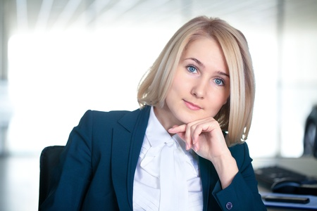 Portrait of attractive businesswoman in the workplace Stock Photo - 18768293