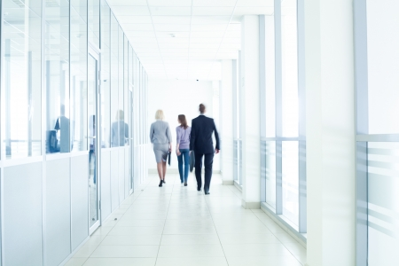 business activity: businesspeople walking in the corridor of an business center, pronounced motion blur