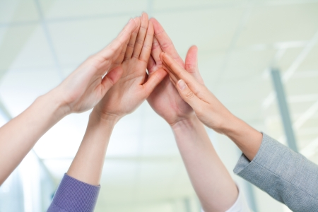 Cropped image of business people hands giving high five Stock Photo