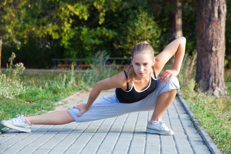 spandex: An attractive female runner stretching before her workout