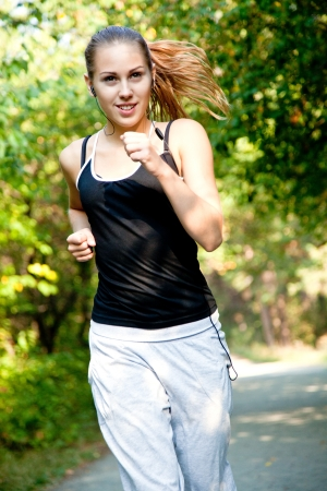 Pretty young girl running in the park Stock Photo - 18768304