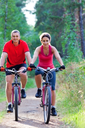 Mature Couple Biking Together in the Park photo