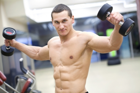 handsome muscular man  in gym   Stock Photo - 19754482