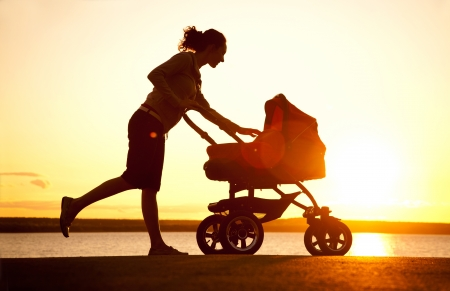 Silhouette of  young mother enjoying motherhood photo