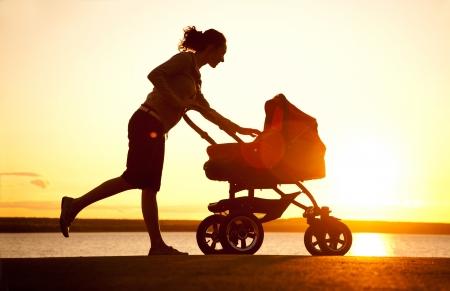 descendants: Silhouette of  young mother enjoying motherhood