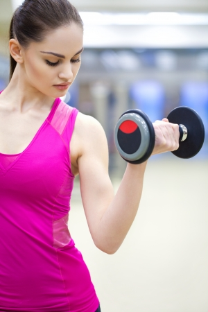 young beautiful woman training in gym Stock Photo - 19774002