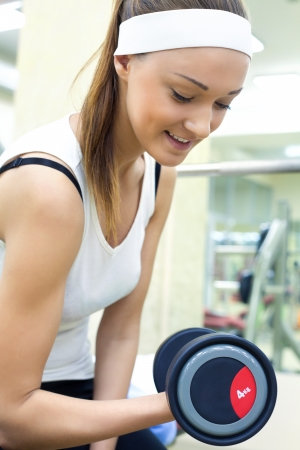 young beautiful woman training in gym Stock Photo - 19773777