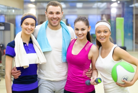 sports club: portrait of young sporty people in gym Stock Photo