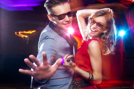 young people fun: young couple having fun dancing at  party. Stock Photo