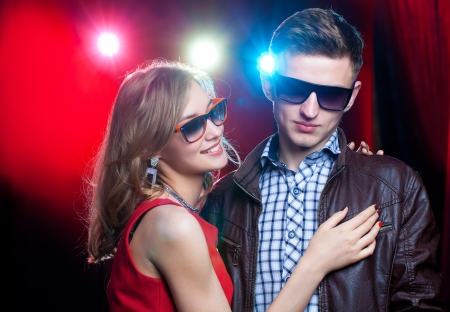 portrait of young man and girl on night party photo