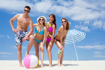 women: Young fun people are having good time on the beach