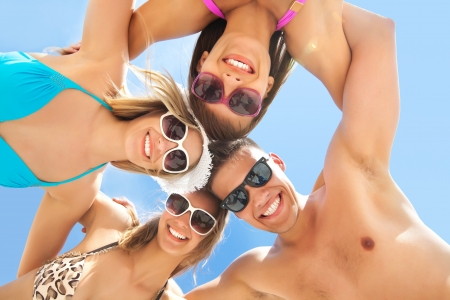 young people fun: Young fun people are having good time on the beach