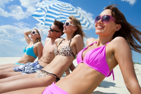 blue bikini: Young fun people are having good time on the beach