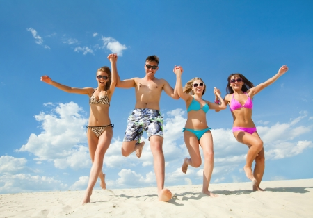fun woman: Young fun people enjoying summer on the beach