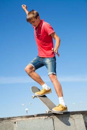 boy skater: cool skateboard is jumping high in air  Stock Photo