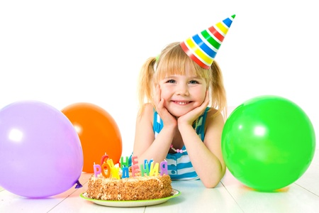 party food: Portrait of cute little girl with birthday's cake