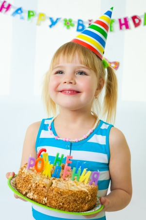Portrait of cute little girl with birthday's cake