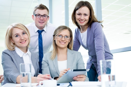 Contemporary business people working in team in the office Stock Photo - 21116985