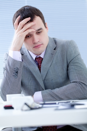 Portrait of businesswoman in stress in office photo
