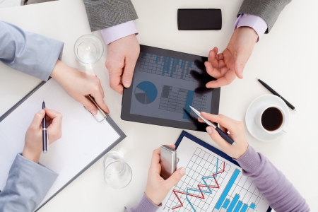 IT: Unrecognizable business colleagues working together and using a digital tablet Stock Photo