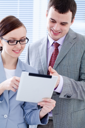 Business colleagues working and holding a digital tablet  photo